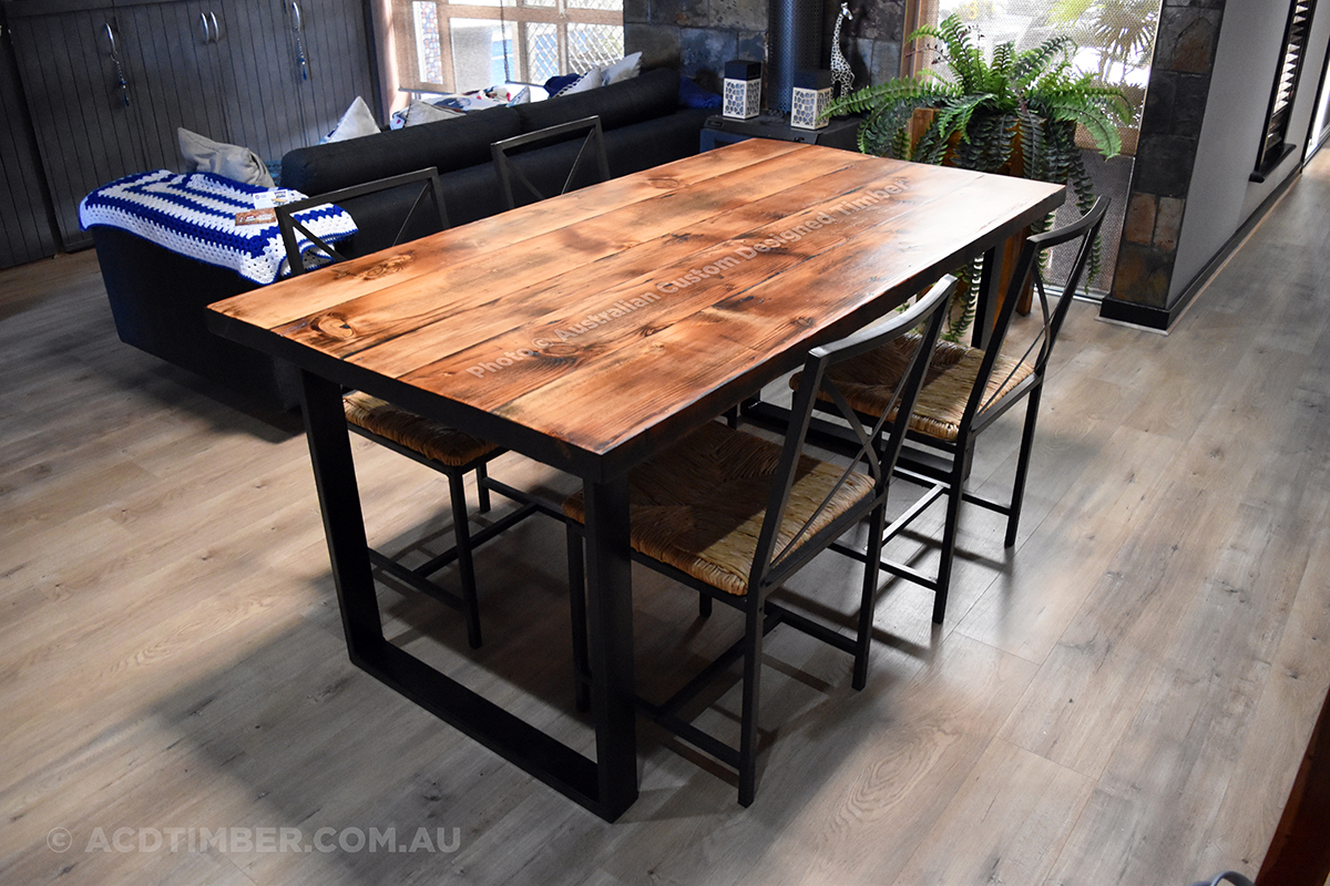 A custom commissioned Industrial Rustic Oregon Dining Table. Aged & reclaimed solid Oregon Timber with steel powdercoated black square legs